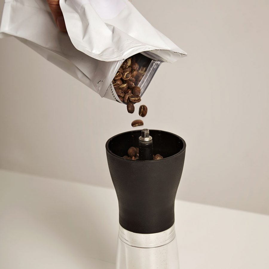 Pouring Coffee To Grind